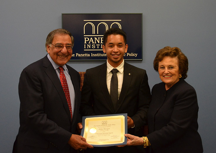 Political science major Philip Abarquez pictured with Leon and Sylvia Panetta.