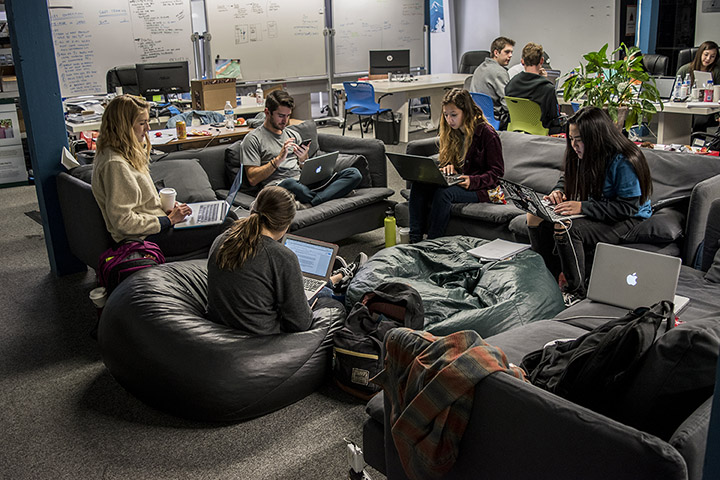 Photo of students working on the HotHouse's couches and beanbags.