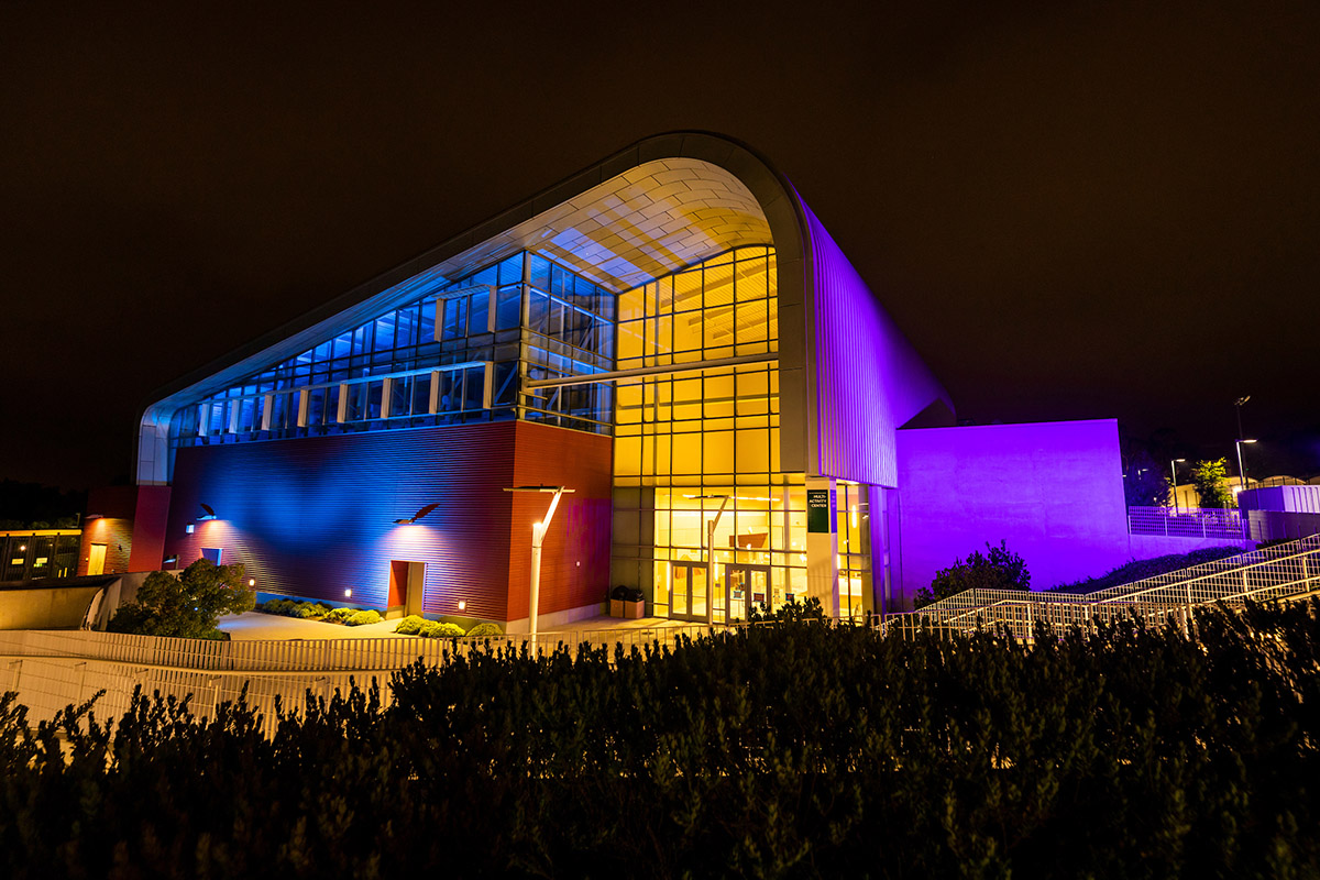 The Cal Poly Recreation Center is illuminated with blue lights to thank health care and other essential workers.