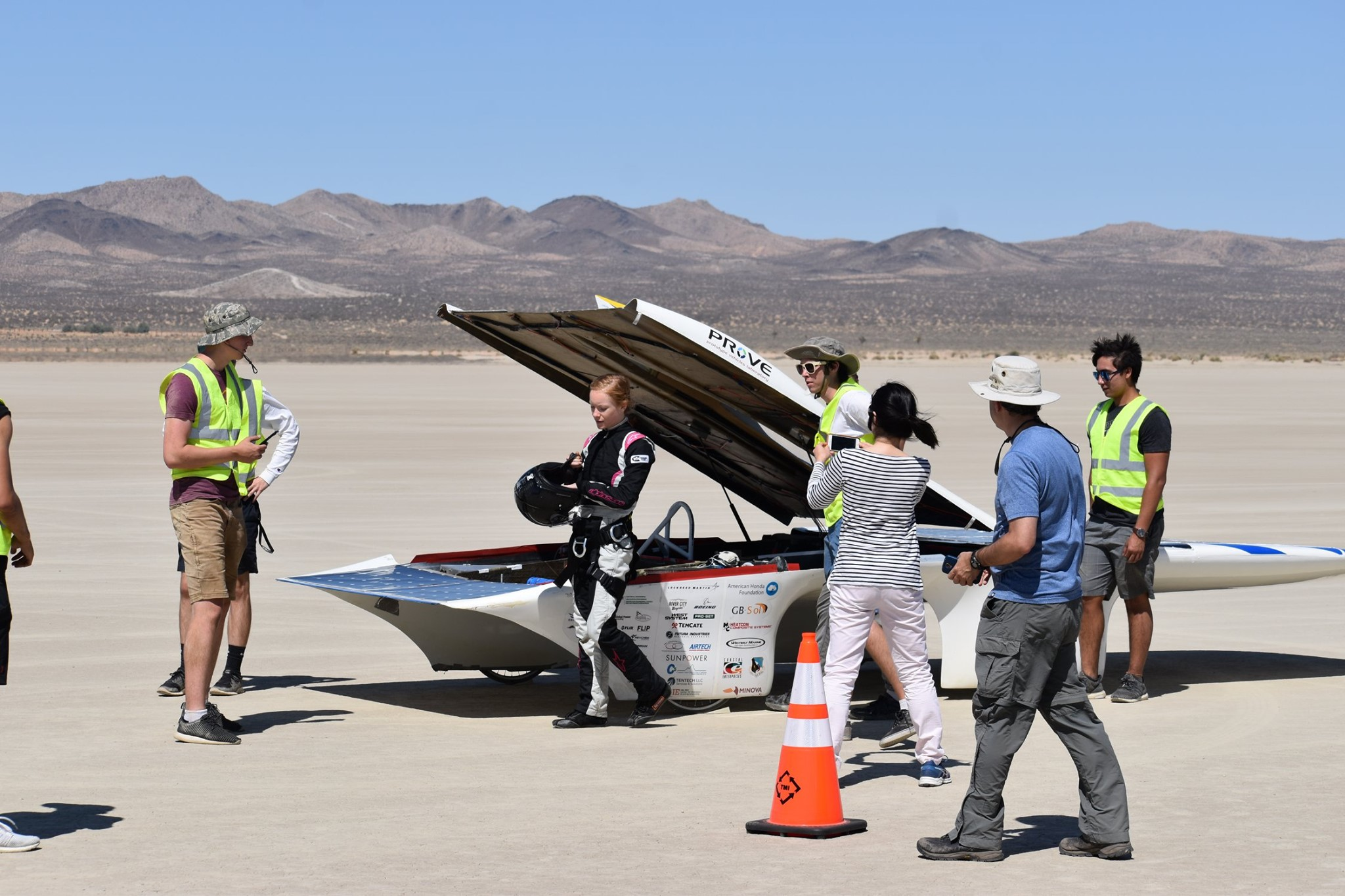 Driver Lacey Davis, an aerospace engineering major from Salinas, California, readies to attempt to set a new record in Cal Poly's Prototype Vehicle Lab's solar car, Dawn, at El Mirage Lake in Southern California. The car clocked 51 mph, below the 56 mph world record, but students are optimistic that the car is capable of hitting 65 mph when they make another attempt next summer.