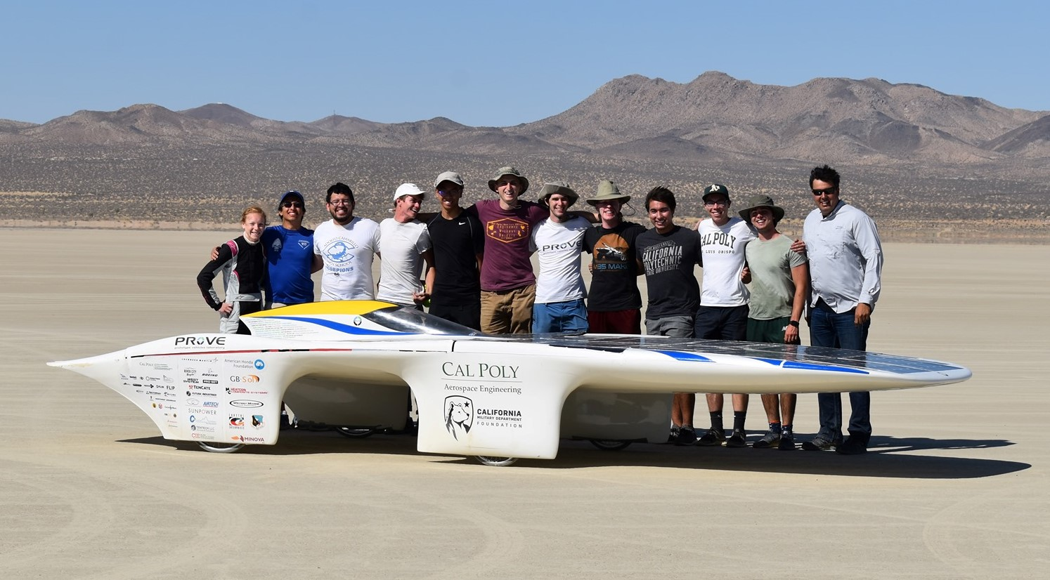 Members of Cal Poly's Prototype Vehicle Laboratory gather around their solar-powered car named Dawn. The team attempted to establish a new world record in August, but reached 51 mph, 5 mph shy of the 2014 record.