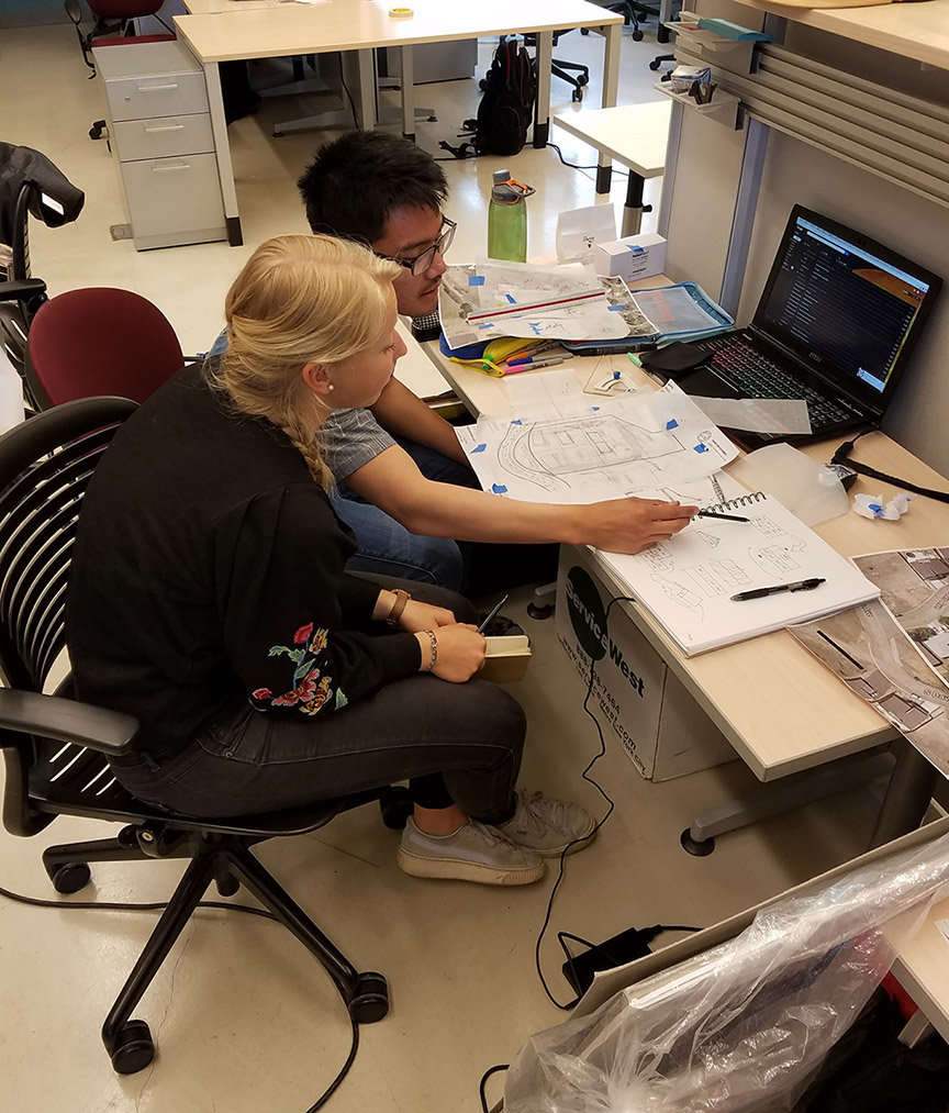 Architecture students Bryan Lee, of San Francisco, and Franziska Beck, of Riedlingen, Germany, work on their design for a home in the city of Weed, California.