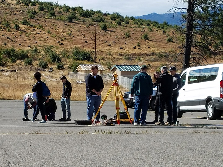Students survey the lot in Weed, California.