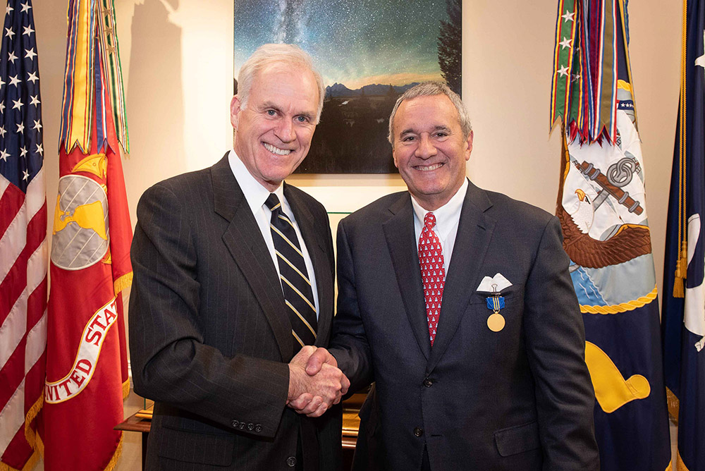 Cal Poly Foundation Board Chair William H. Swanson, right, receives the Department of the Navy Distinguished Civilian Service Award from Secretary of the Navy Richard V. Spencer. (Photo courtesy of the U.S. Navy)