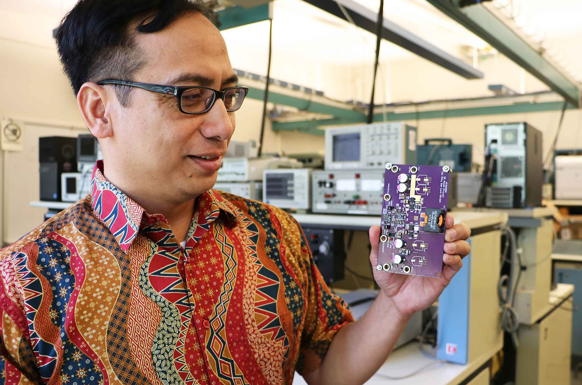 Cal Poly electrical engineering professor Taufik, who uses only one name, holds a prototype of said his soon-to-be patented device that could provide light to the more than 1.6 billion people living far off the grid. The U.S. Patent and Trademark Office has told Taufik that the patent would be awarded this fall.