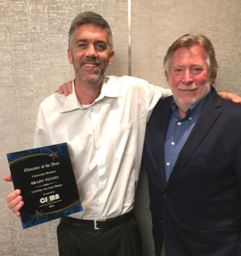 Paul Bittick (right), a previous Educator of the Year honoree, presented the California Journalism and Media Affiliates' 2018 Journalism Educator of the Year – 4-Year Division award to his Cal Poly colleague, Brady Teufel, during the California College Media Association Awards Banquet on Saturday, March 3, in Long Beach. (Photo by Joe Wirt/CNPA Services Inc.)