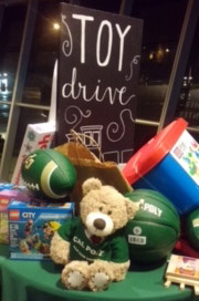 Photo of toys on a table at the 2016 toy drive at Cal Poly.
