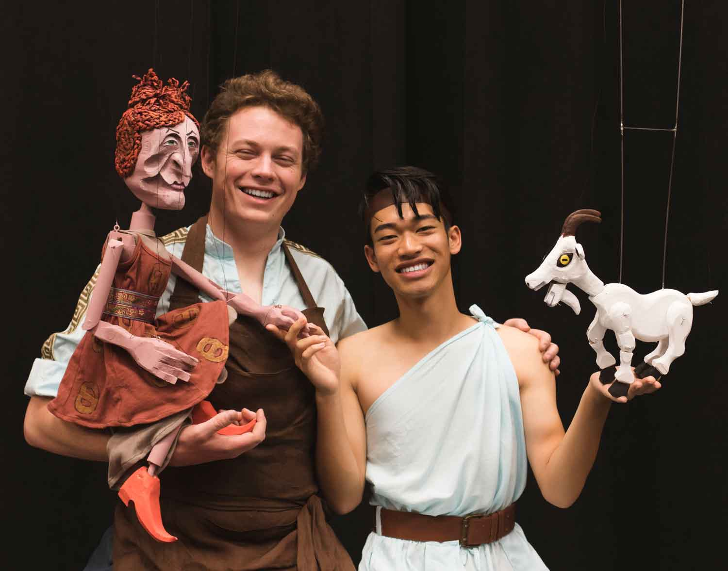 "Aidan Turner, left, as Daedalus and Romelo Urbi as Icarus, interact with two puppets from the show, ""Trust Fall."""