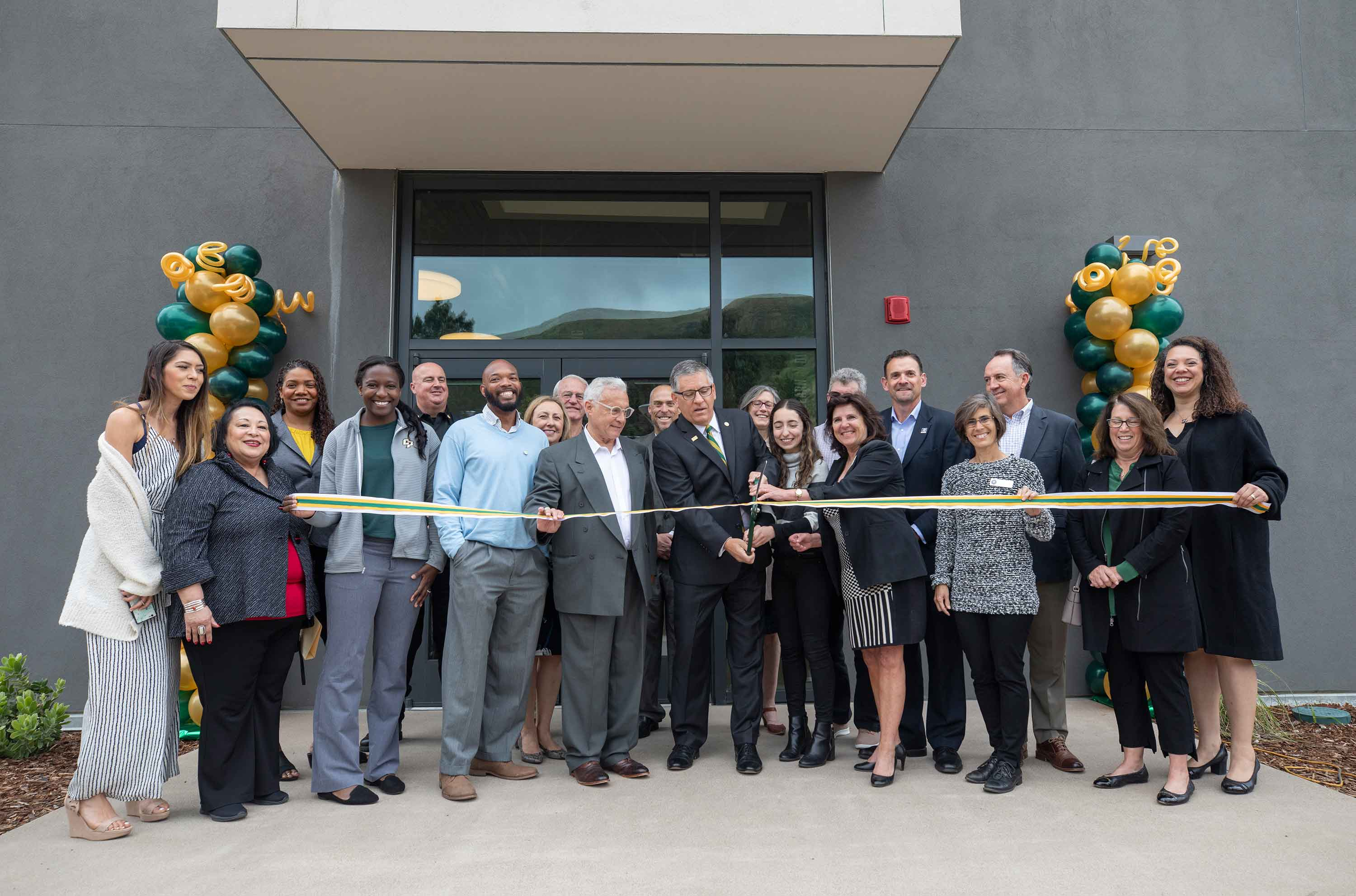 President Armstrong and other university and community leaders cut the ribbon on the new Welcome Center on April 30