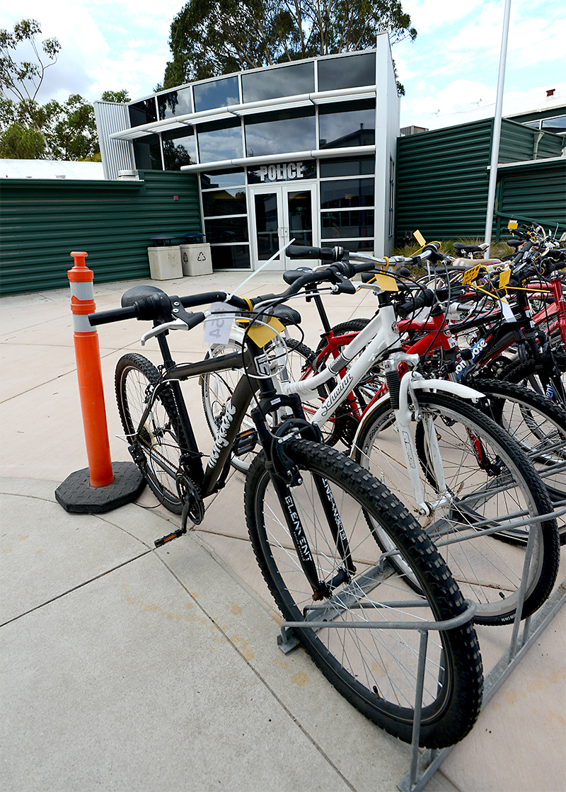 Dozens of bicycles in Cal Poly Police bike racks