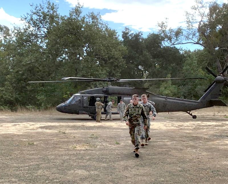 Cal Poly ROTC student exit a Black Hawk helicopter