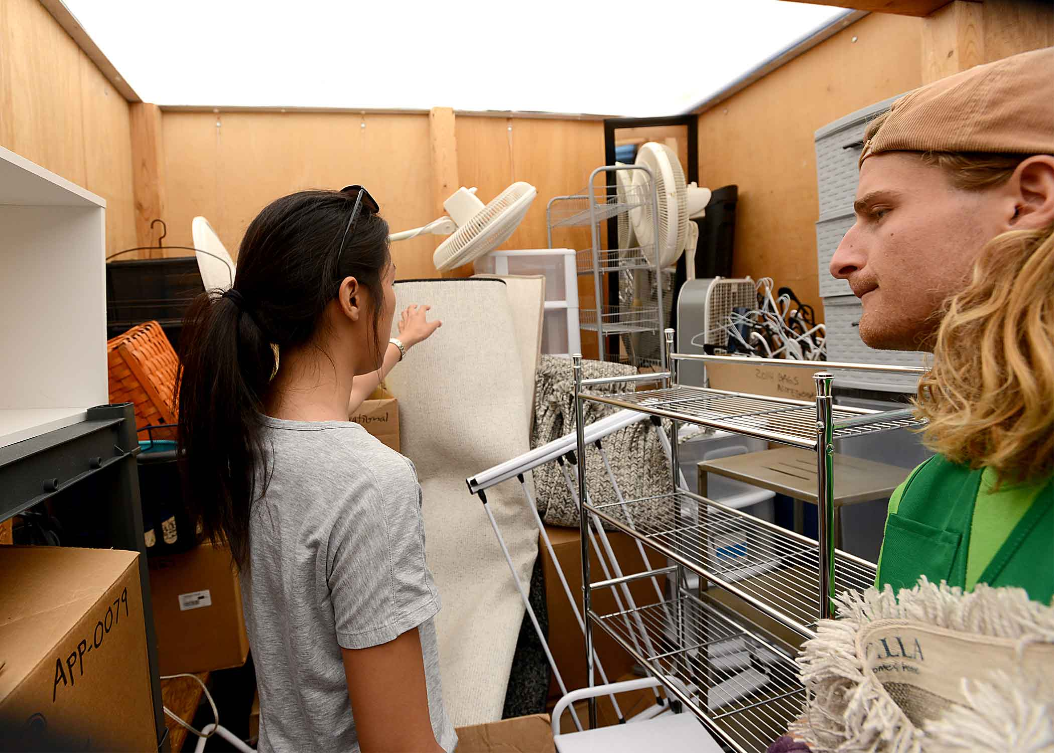 Adam Simon, right and Darin Son of Irvine, California, examine donated items that will be sold in September at the CP Thrift sale.