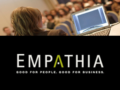 Photo of a woman looking at a computer screen along with the Empathia logo