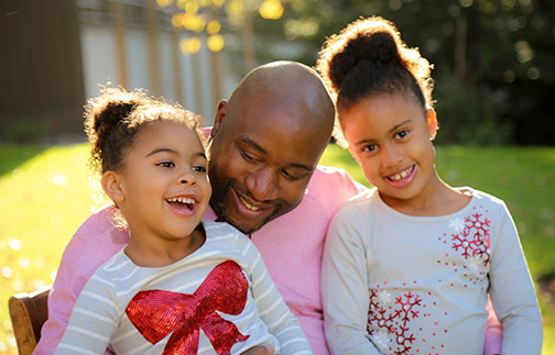 Photo of Jamie Patton, Cal Poly's assistant vice president for Student Affairs — Diversity and Inclusion, with his daughters.