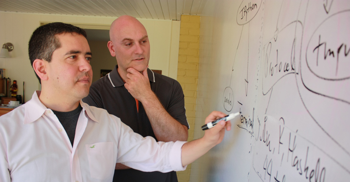 Cal Poly physics Professor Brian Granger (right) and Fernando Pérez of UC Berkeley discuss the architecture of Project Jupyter, an open-source software they helped develop that has changed the way work is done in industries ranging from genetics to finance.