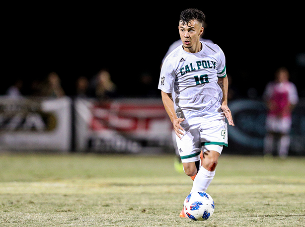 A Cal Poly soccer player advances with ball