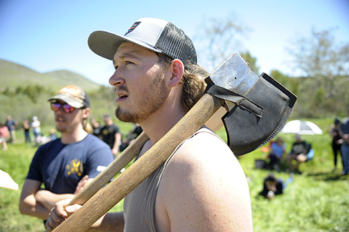 Will Kraemer, front, a bioresource and agricultural engineering junior and president of the Cal Poly Logging Team.