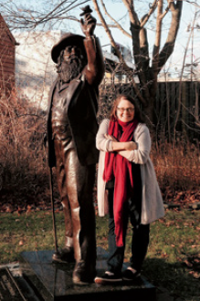 Catherine Waitinas in front of Walt Whitman statue