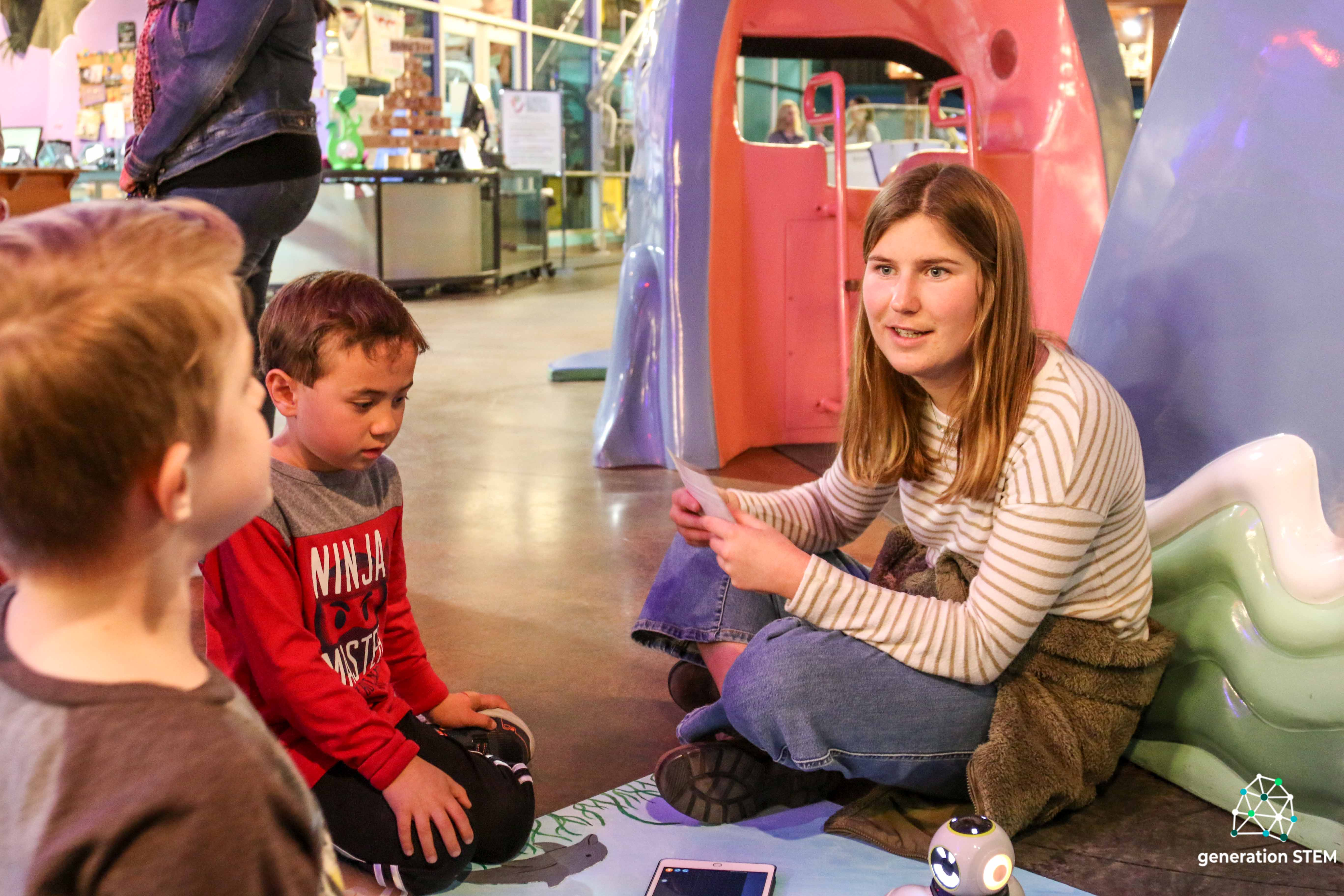 Louisa Nickerson (Liberal Arts and Engineering Studies, '20) teaches kids robotic programming at the Santa Maria Valley Discovery Museum.
