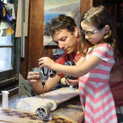 Matt Berger with daughter building a skateboard