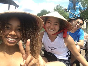 Mizuki (center) on a boat tour exploring the Mekong Delta.