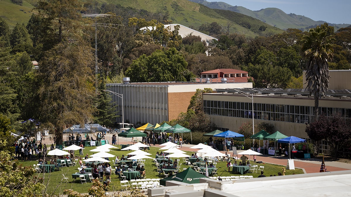 The campus community gathers for an outdoor event on Dexter Lawn