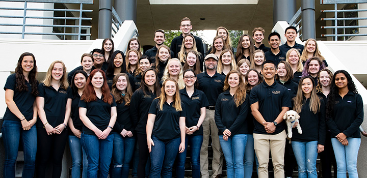 Group image of the 2019 cohort of COSAM Ambassador students and Dean Wendt outside building 25 on the Cal Poly campus