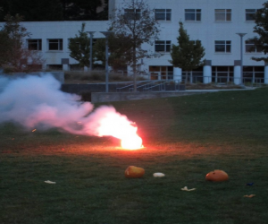 Smoke and ember waft from a pumpkin about to explode