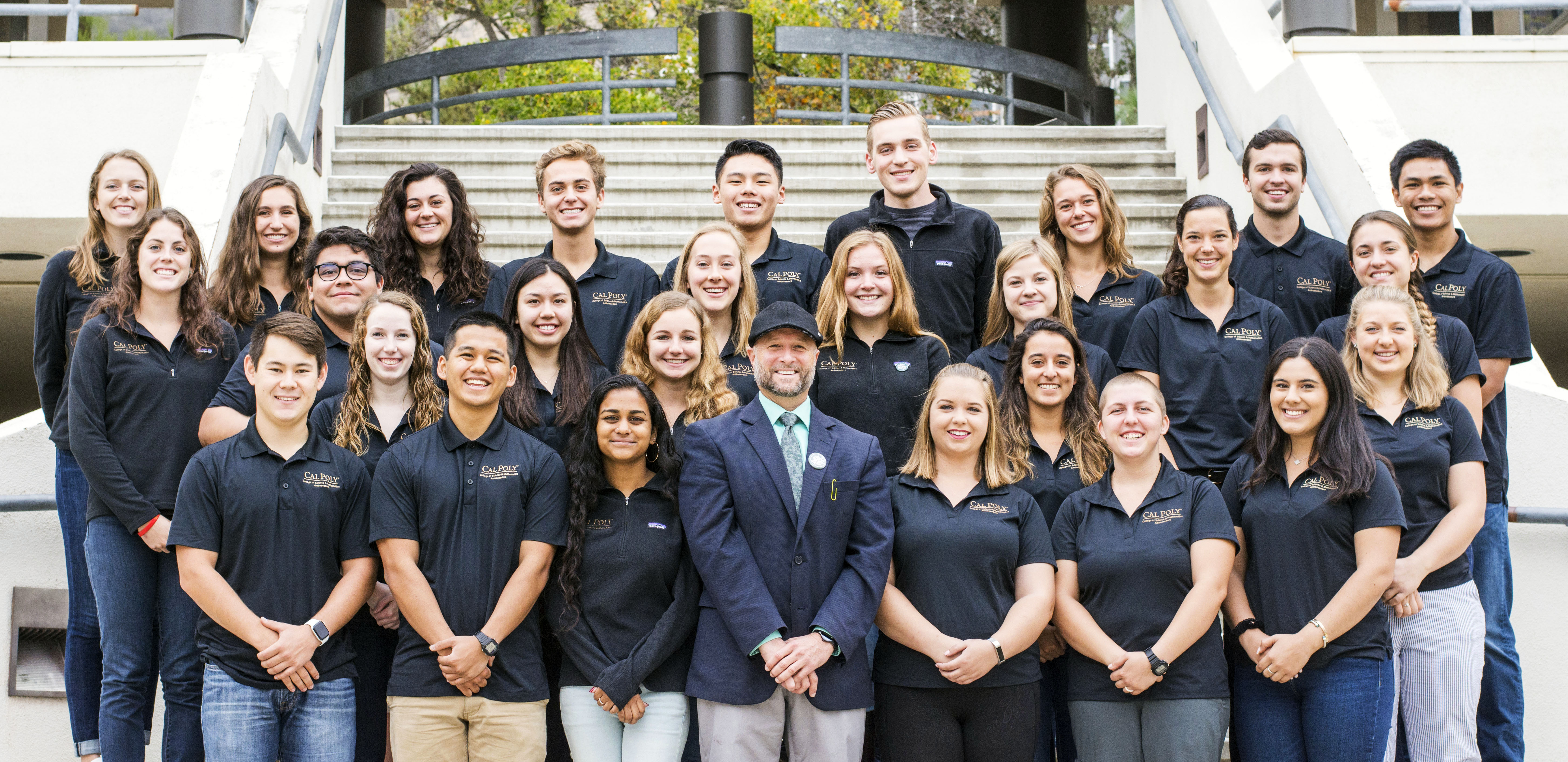 Group image of the 2018 cohort of COSAM Ambassador students and Dean Wendt outside building 25 on the Cal Poly campus