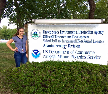 Samantha Bock next to EPA sign
