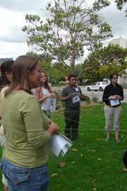 Group of teachers standing in a circle with strings to show the food web