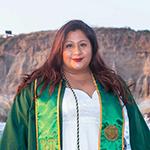 Francisca Camarillo's graduation photo besides a beachside cliff.