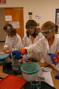 elementary students doing science experiment
