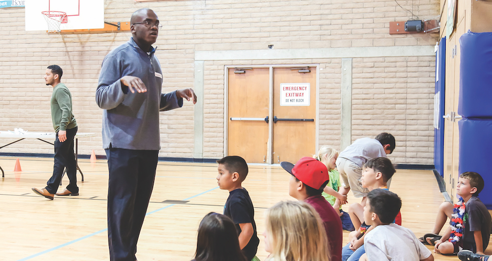 Immanuel Williams instructs children at the Boys and Girls Club in Santa Cruz, California.