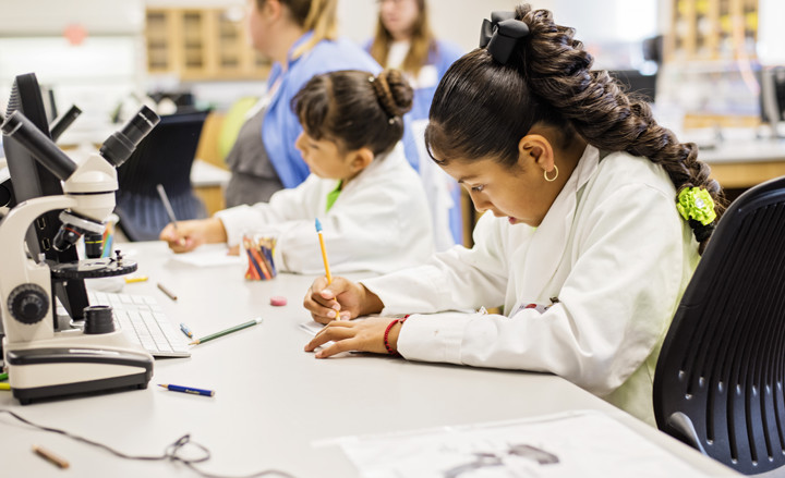 Girl taking notes at the Summer Learn by Doing lab