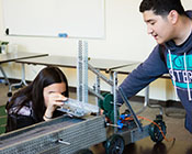 Student engineering a robot