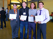 Student winners holding certificates