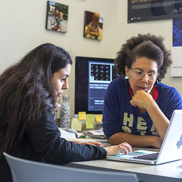 Physics Professor Louise Edwards (right) and Priscilla Holguin West (left) having a discussion.