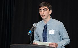 Jason Brown speaking at a podium