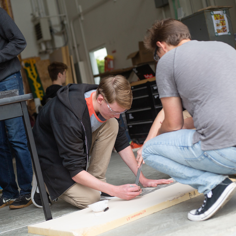 Students work on constructing their prototype for the spaceX competition.