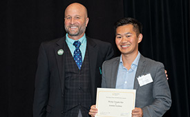Wesley Kao holds his certificate and stands with Dean Wendt