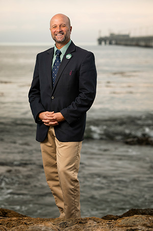 Dean Wendt in front of Cal Poly Pier and ocean