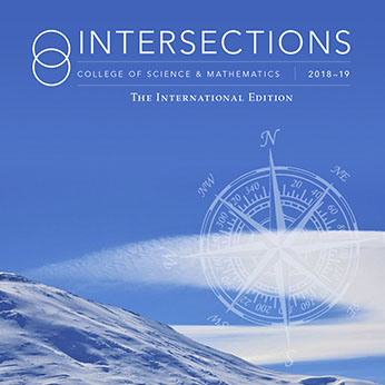 Intersections, The International Edition 2018-19 cover with a white compass over a blue arctic sky.