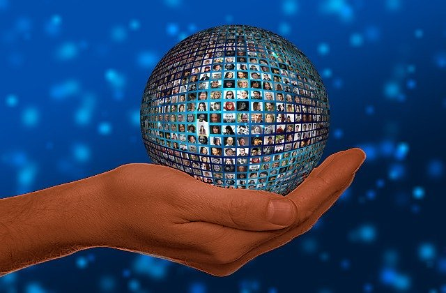 image of hand holding a faceted planet with diverse people