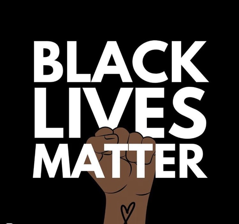"""Square image with a black background and  """"BLACK LIVES MATTER'' written over a brown fist. The fist has a black heart on the wrist."""