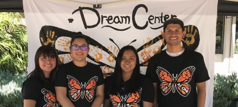 Picture of students in front of a Dream Center banner