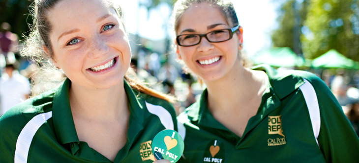 Two Poly Rep women broadly smiling into the camera
