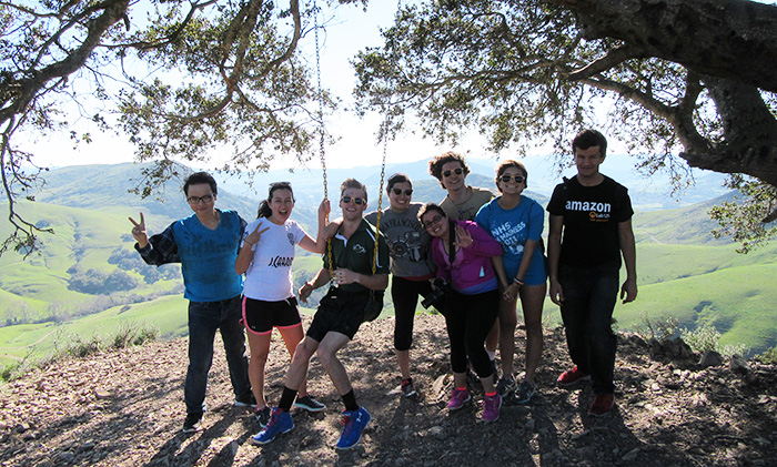 A group of students at the Serenity Swing above Poly Canyon