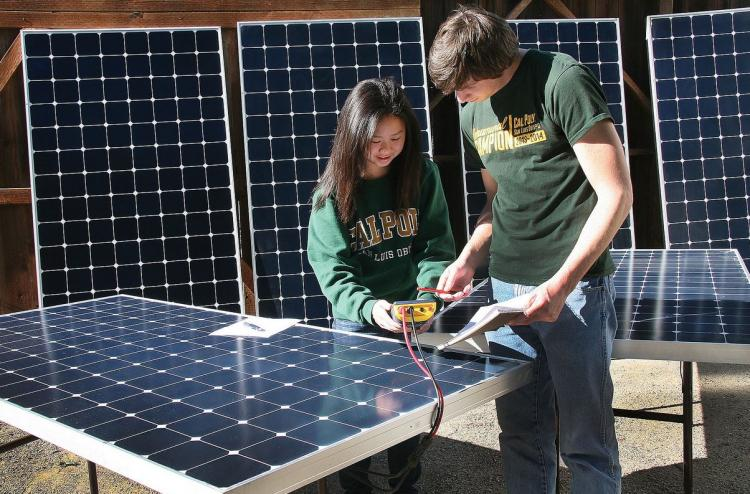Coleen Cheung and Jacob Michener testing solar panels