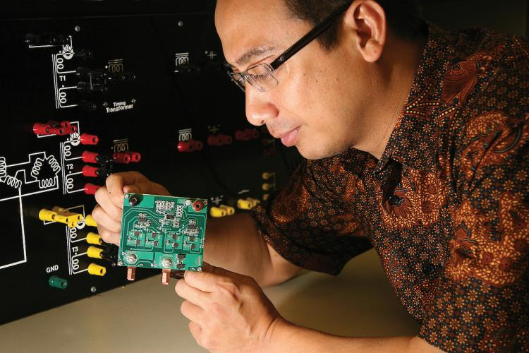 Professor Taufik working on project